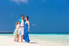 Family on a tropical beach vacation. Happy beautiful family on a tropical beach vacation Royalty Free Stock Photography