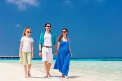 Family on a tropical beach vacation. Happy beautiful family on a tropical beach vacation Stock Photography