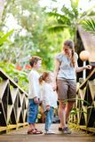 Family at tropical jungle resort Royalty Free Stock Image