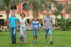 Family at tropical resort. Royalty Free Stock Photos