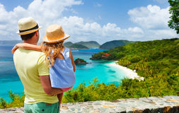 Family at Trunk bay on St John island. Family of father and daughter enjoying aerial view of picturesque Trunk bay on St John island, US Virgin Islands Royalty Free Stock Image