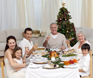 Family tusting with white wine fo Christmas. Family tusting with white wine in a Christmas dinner at home Stock Photo
