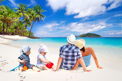 Family with twins on sun holidays. At the tropical beach Royalty Free Stock Photos