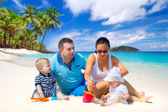 Family with twins on sun holidays Royalty Free Stock Photo