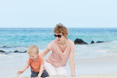 Family of two at the beach Royalty Free Stock Photo