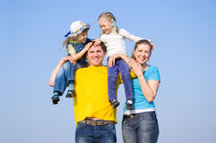 A family with two children. At the background of the sky Royalty Free Stock Photography