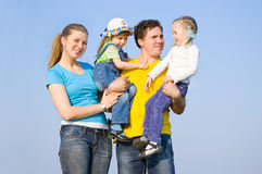 A family with two children Stock Photography
