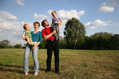 Family with two children Stock Images