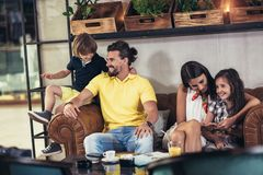 Family with two children having great time in a cafe after shopping. Having fun stock images