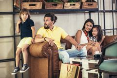 Family with two children having great time in a cafe after shopping. Having fun stock photography