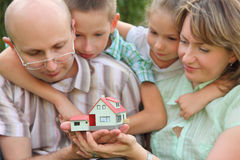 Family with two children is keeping wendy house Stock Photography
