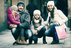 Family with two children posing Stock Images