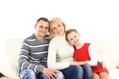 Family with two children sitting Royalty Free Stock Image