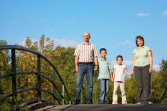 Family with two children is standing on bridge Stock Photos