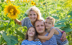 Family with two children in sunflower field Stock Image