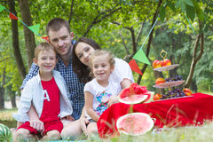 Family with two children on watermelon picnic outdoor Stock Photo