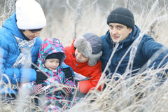 Family with two children in  winter  nature Royalty Free Stock Photography