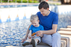Family of two by the city fountain Stock Photography