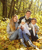 Family with two daughters in autumn forest Royalty Free Stock Images