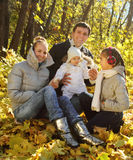 Family with two daughters in autumn forest Stock Image