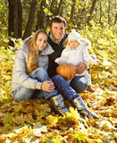 Family with two daughters in autumn forest Stock Photography