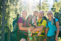 Family with two daughters on hike in the woods Royalty Free Stock Photography
