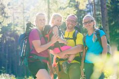 Family with two daughters on hike in the woods Royalty Free Stock Photo