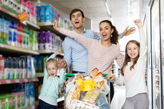 Family with two daughters shopping in local supermarket Stock Photos
