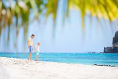 Family at vacation. Family of two, father and son, enjoying white sand beach at beautiful tropical fiji island, vacation concept Royalty Free Stock Image