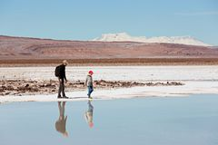 Family vacation in chile. Family of two, father and son, hiking and walking together enjoying salty lagunas escondidas in atacama desert, chile, healthy active Royalty Free Stock Images