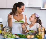 Family of two having healthy lunch with veggies Stock Image