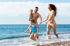 Family with two kids on beach Royalty Free Stock Photography