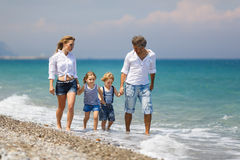 Family with two kids on the beach Royalty Free Stock Images