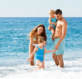 Family with two kids on beach Stock Photography