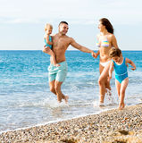 Family with two kids on beach Stock Image