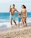 Family with two kids on beach Stock Images