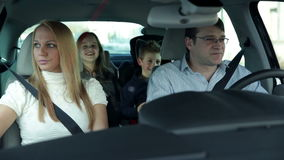 Family with two kids going to vacation with car stock video