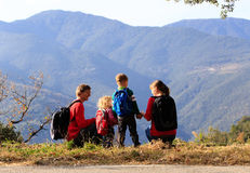 Family with two kids hiking in mountains Stock Photos