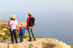 Family with two kids hiking in scenic mountains Royalty Free Stock Images