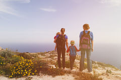 Family with two kids hiking in scenic mountains Stock Image