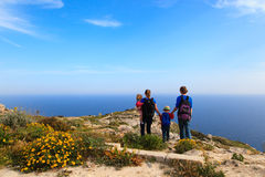 Family with two kids hiking in summer mountains Royalty Free Stock Photo