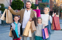 Family with two kids holding shopping bags Stock Images