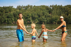 Family and two kids in a lake Stock Image