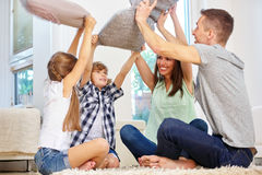 Family with two kids making pillow fight Royalty Free Stock Images