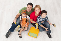Family with two kids ready to pait their home Stock Photos