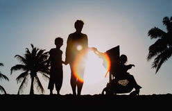 Family with two kids on sunset beach Royalty Free Stock Image