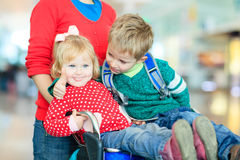 Family with two kids travel in the airport Stock Photos