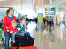 Family with two kids travel in the airport Royalty Free Stock Photography