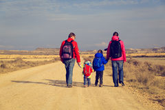Family with two kids walking on scenic road, tourism concept Stock Image