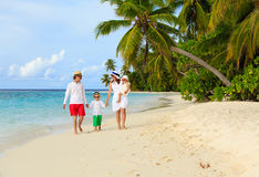 Family with two kids walking at tropical beach Royalty Free Stock Images